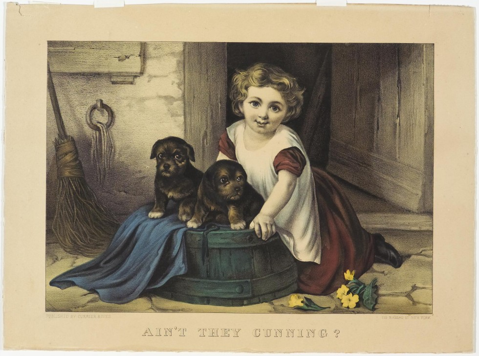 Girl seated at barrel outside doorway with two pups to her left
