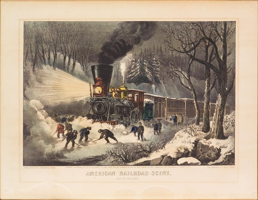 Evening scene of a passenger train stopped on the tracks while about a dozen men shovel snow off tracks ahead