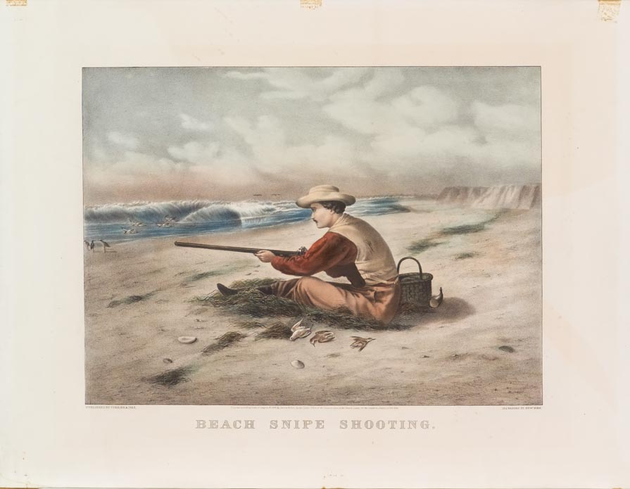 Scene of a man sitting in sand on beach