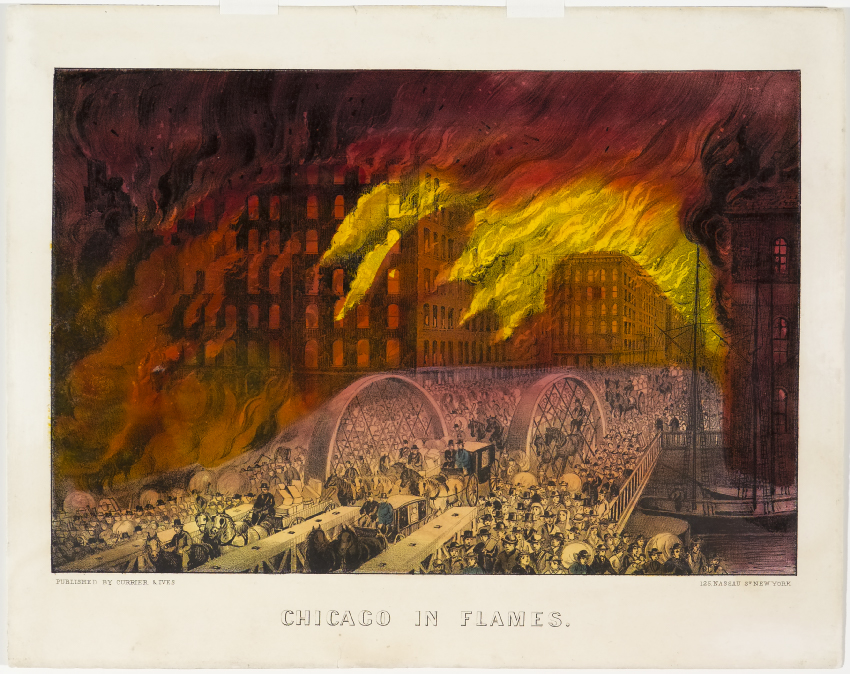 Buildings ablaze at center and to background