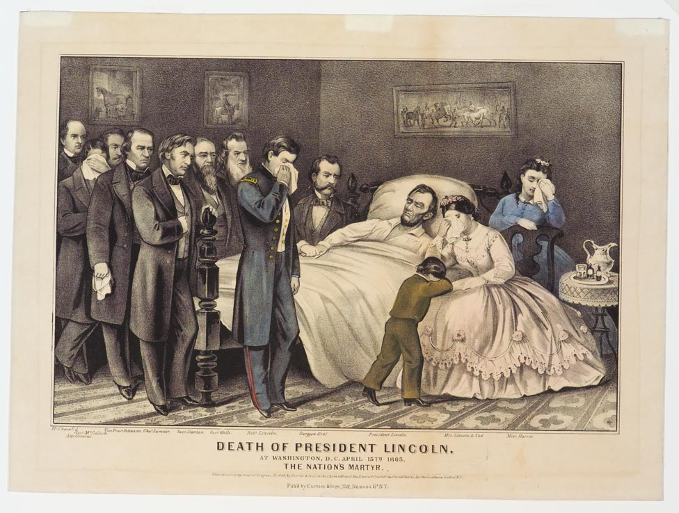 Lincoln lying on bed with Mrs