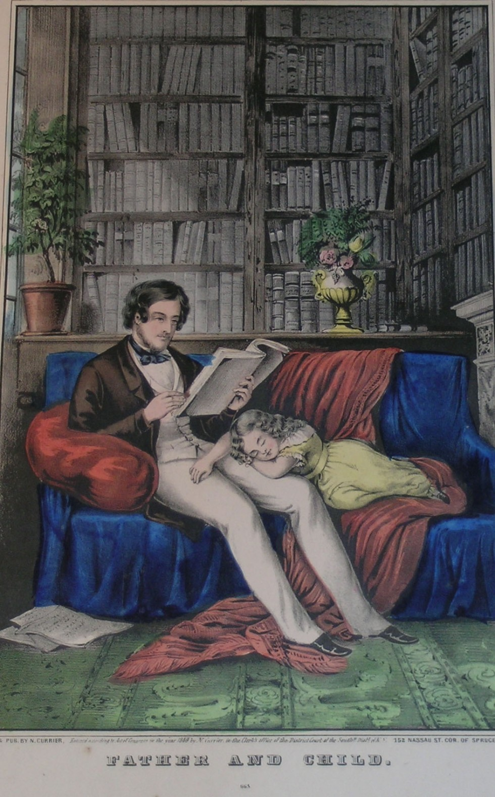 Interior of a study with father reading a book sitting on a couch and daughter fast asleep in his lap
