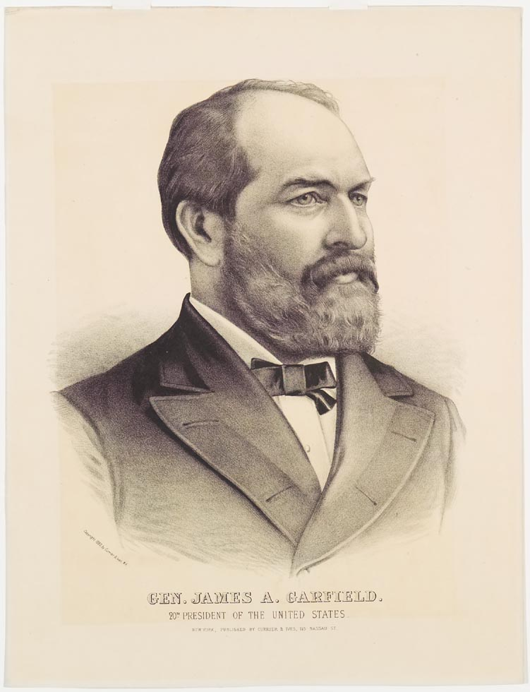 Shoulder length portrait of bearded man in suit facing out to right in image