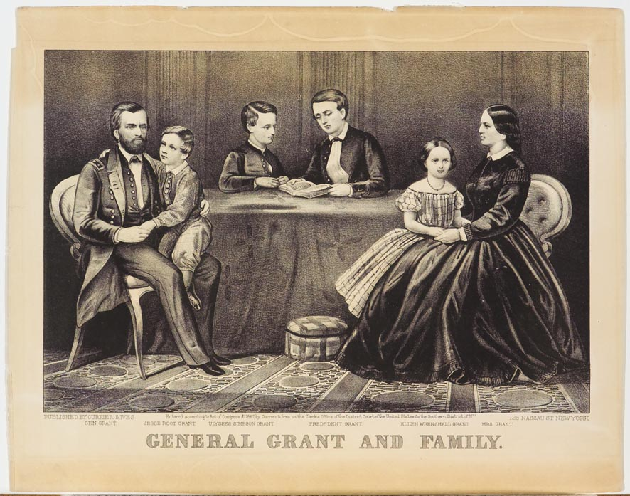 Two adults with three children - adults seated around table
