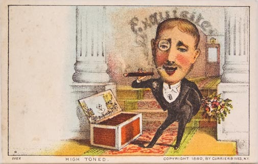 Man wearing a monocle and smoking a cigar standing aside a large box of cigars