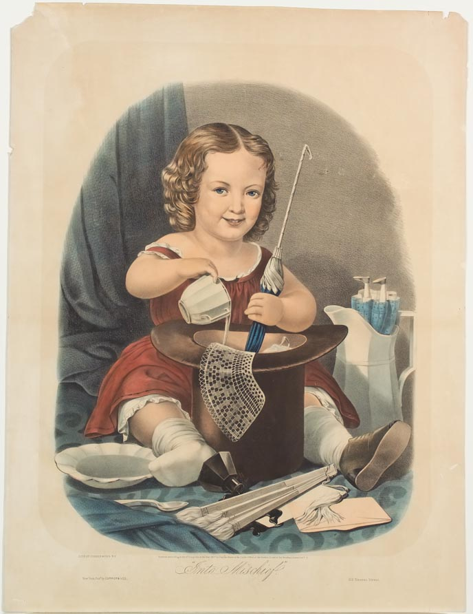 Young girl in red dress sitting on floor behind a top hat into which she is pouring milk and stirring with an umbrella