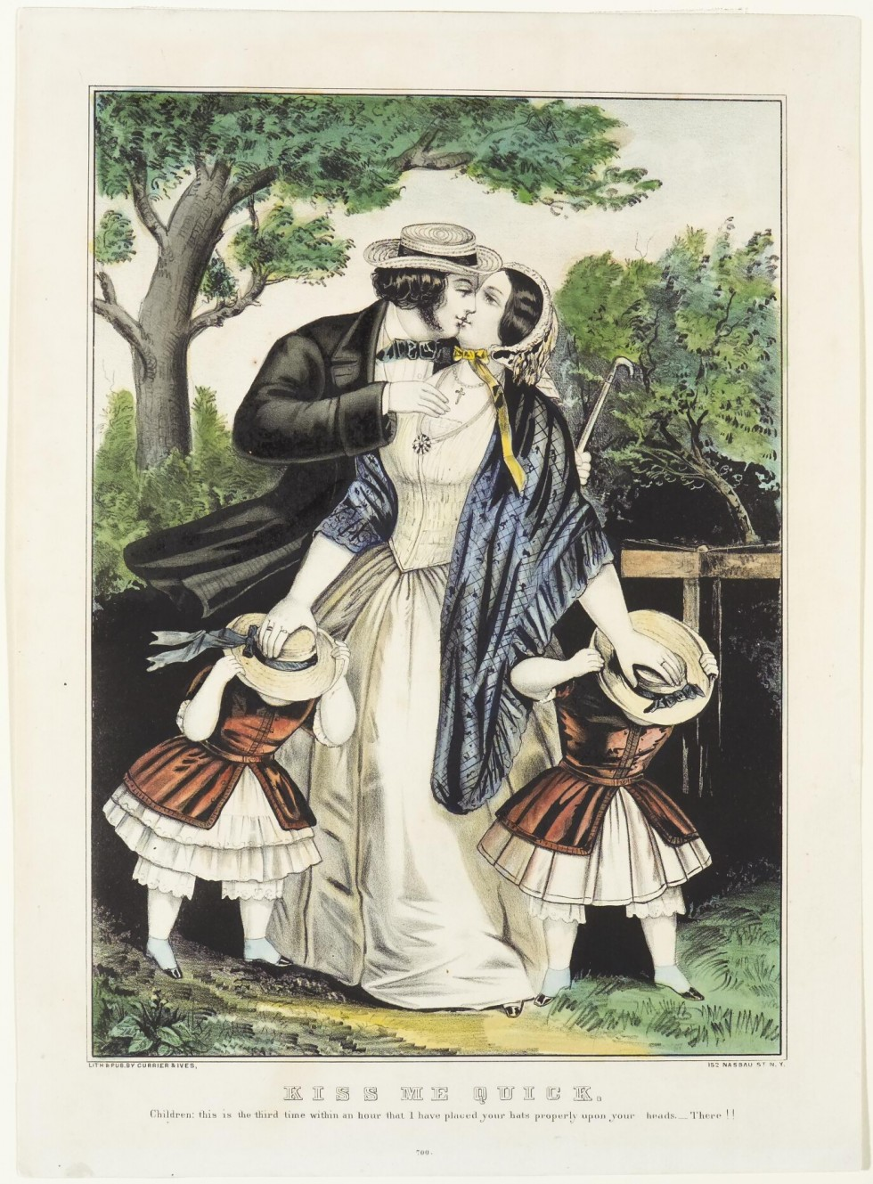 Couple (man to left) kissing with two daughters aside woman's skirts