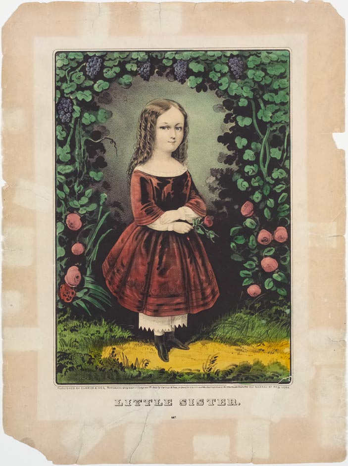 Young girl in red dress standing within a three sided arbor garland of roses and grapes