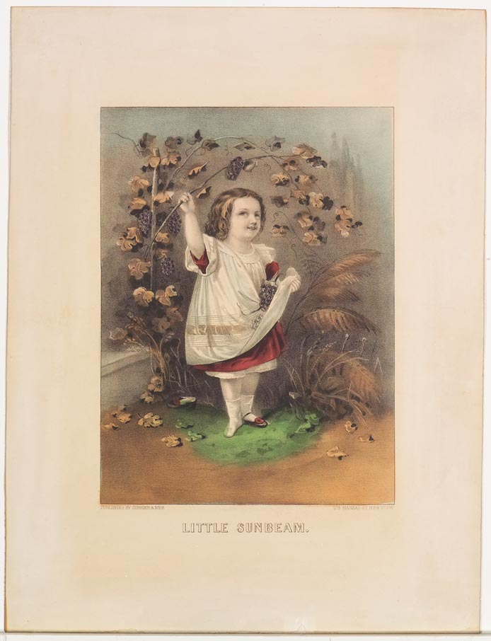 Little girl standing at center under bough of bunches of grapes and leaves