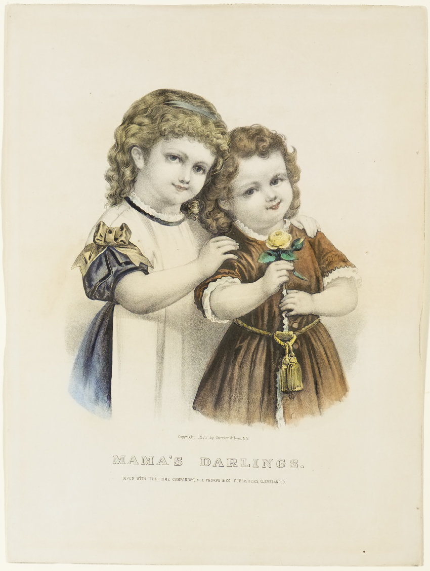 Two young girls looking forward at viewer