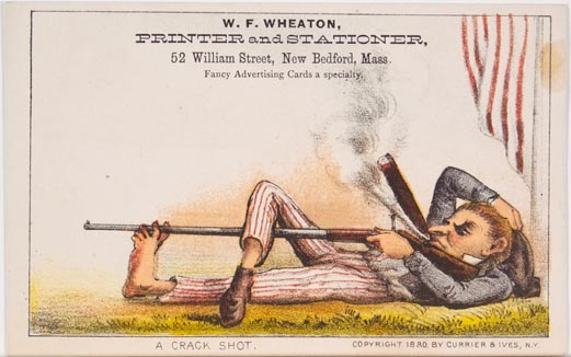 Man lying on grass smoking a cigar with rifle in hand extending down through toes of his left foot