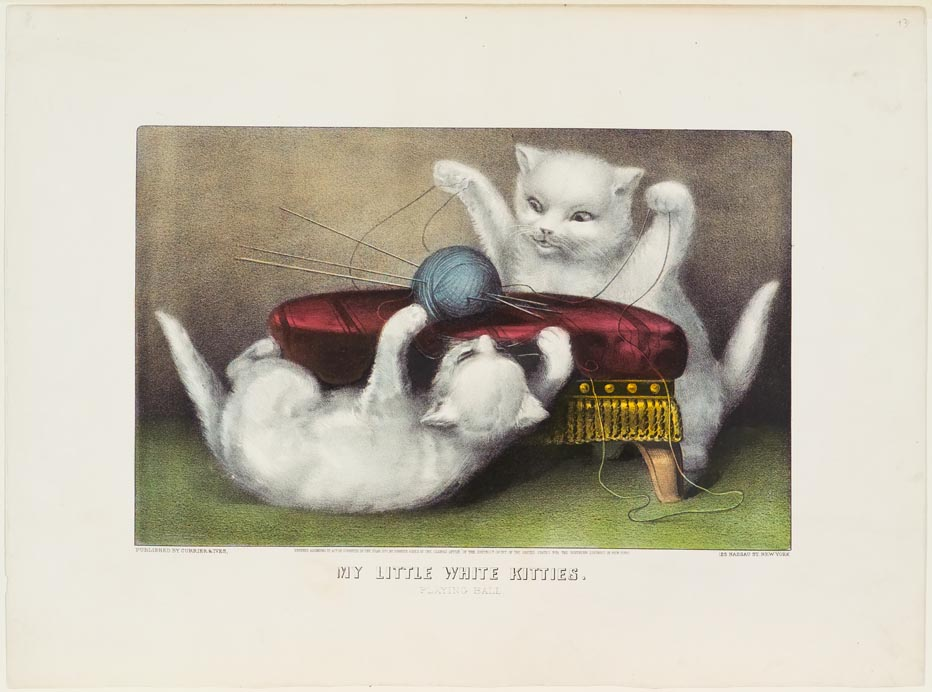 Two white kittens playing with ball of blue yarn