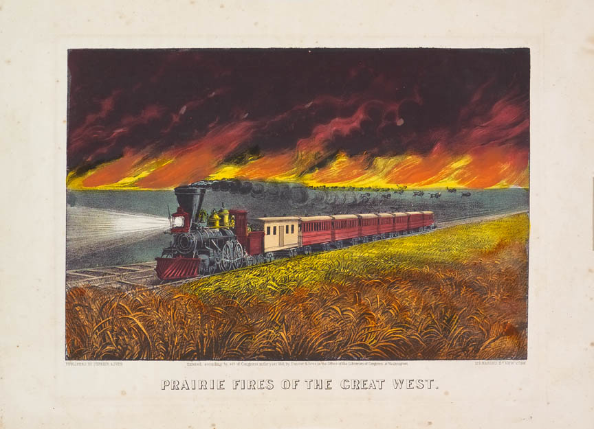 Train traveling toward viewer's left- fire ranging in background to left