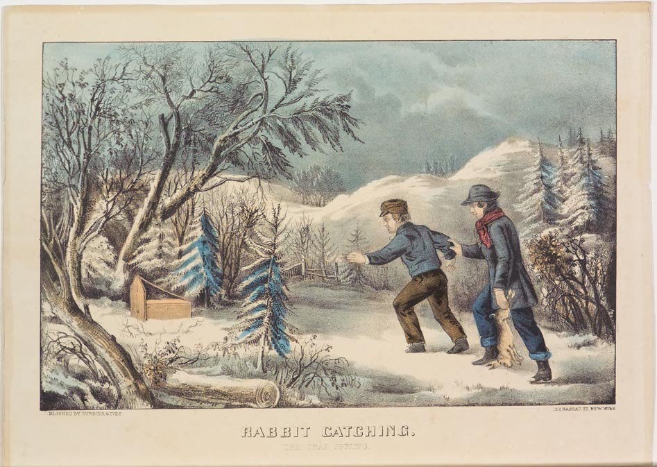 Two men (one to right carrying a rabbit) walking up snowy path into wooded area to check trap