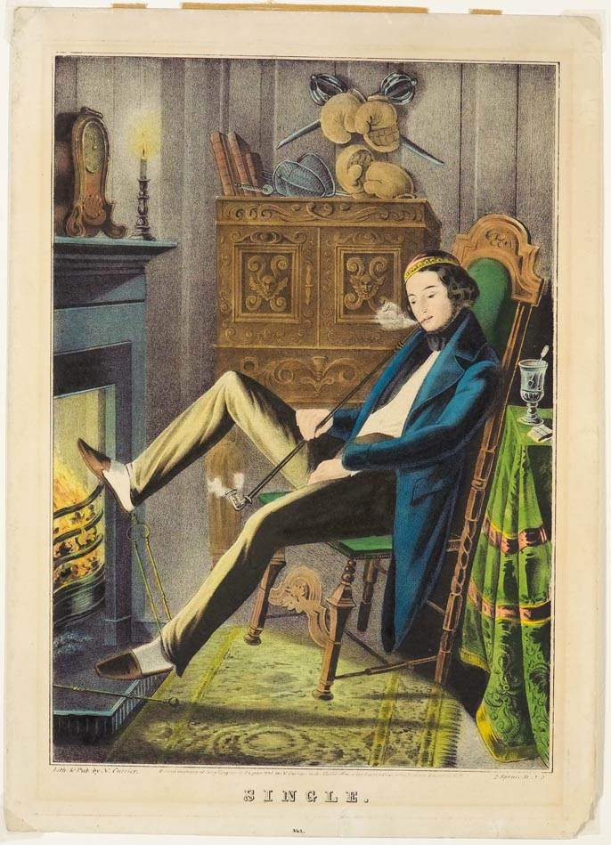 Young man smoking long-handled pipe sitting on chair in front of fireplace with proper right foot resting on top of grate