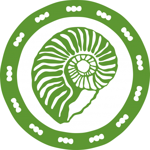 Green, circular medallion with a fossil in the center.