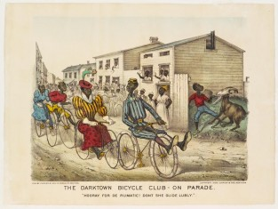 "The Darktown Bicycle Club – On Parade. ""Hooray For De Rumatic! Don't She Glipe Lubly."", Currier & Ives"
