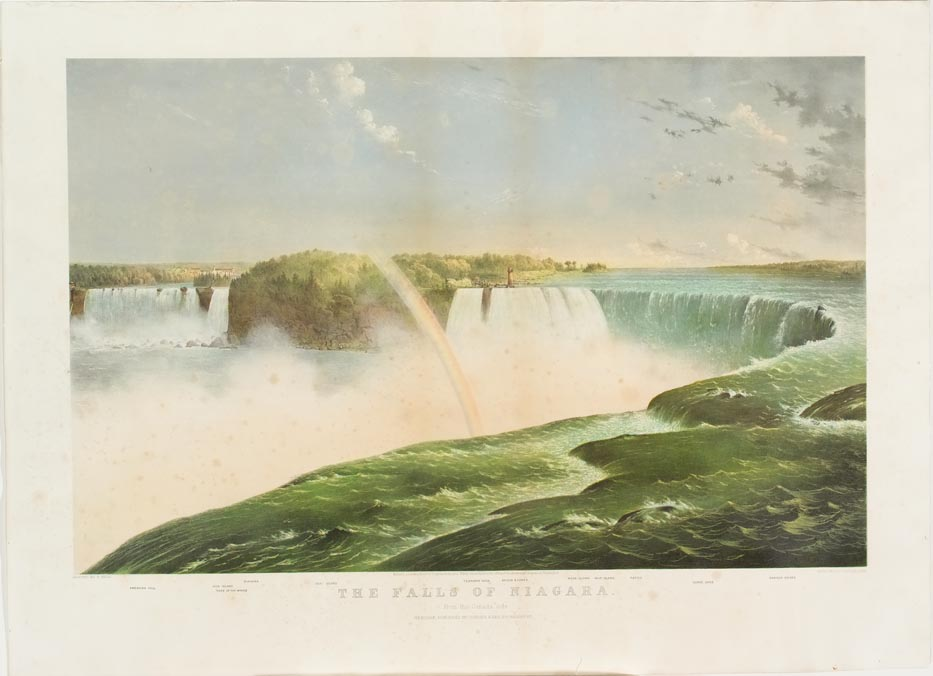 Falls in foreground with rainbow curled to right and down into falls