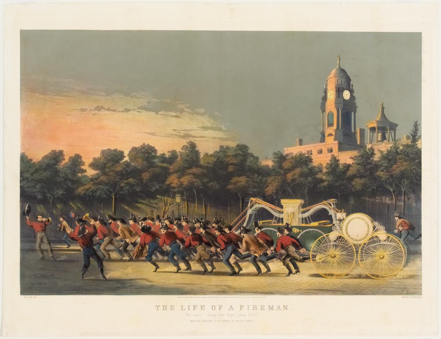 Two teams of firemen pulling wagons to left in image