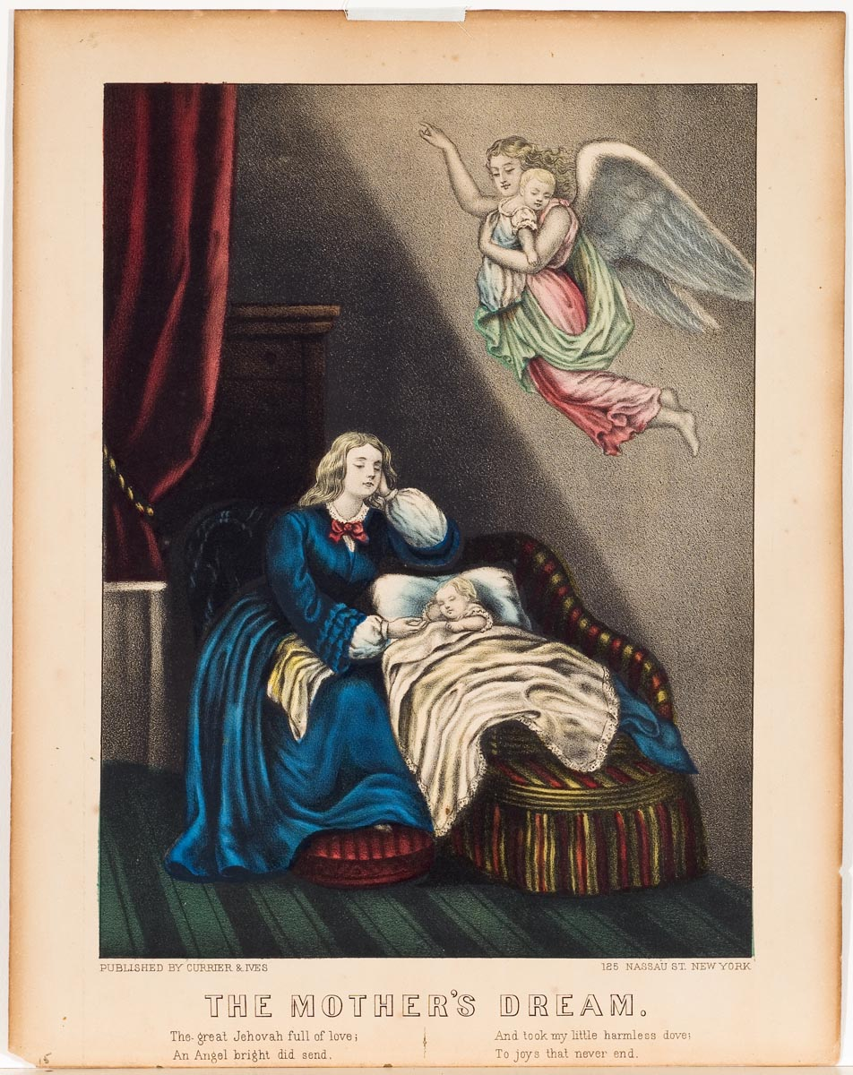 Woman in blue dress seated next to chaise where there is a sleeping child