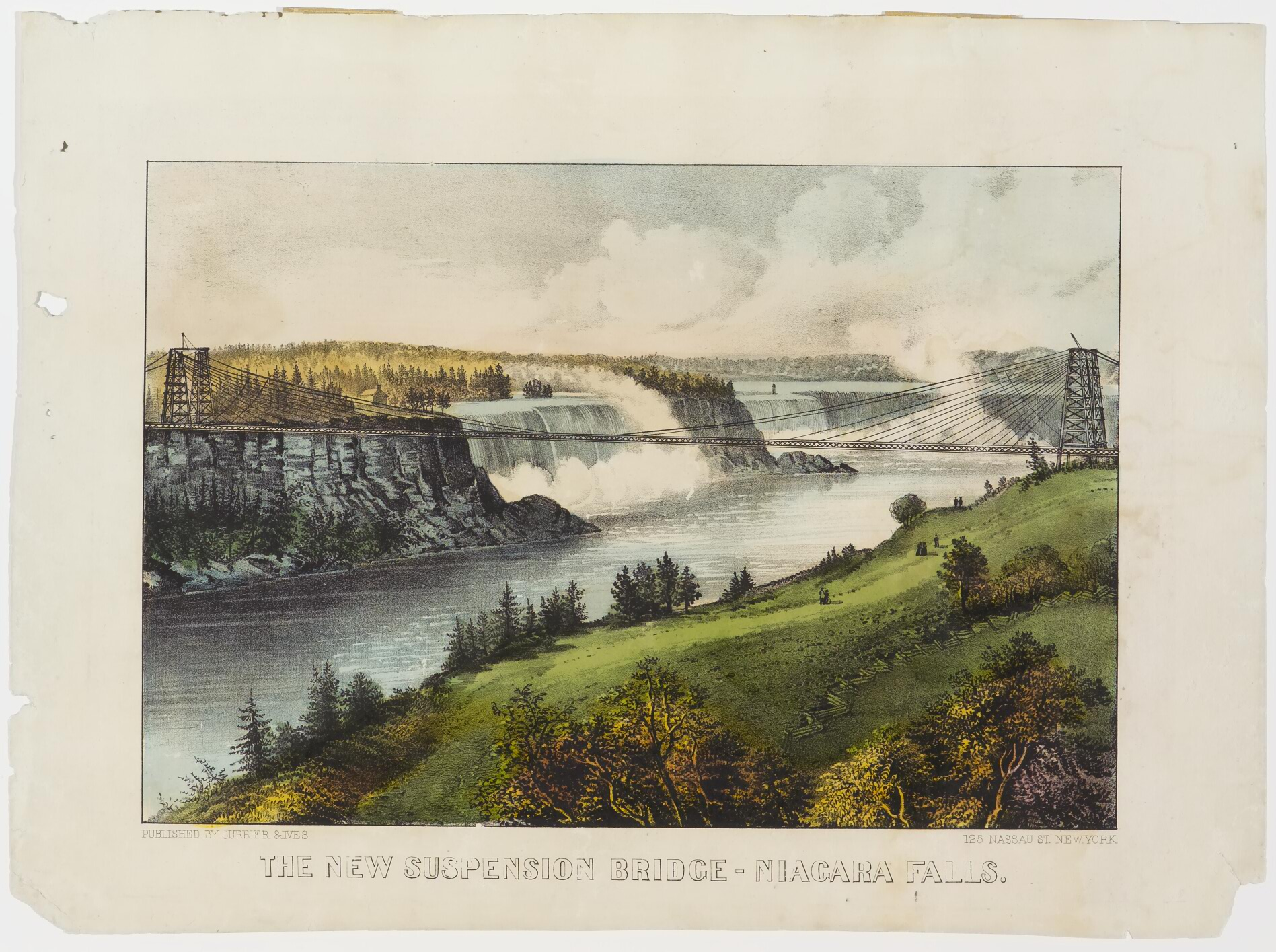 Falls in background; bridge crossing from cliffs on left to grasslands on right