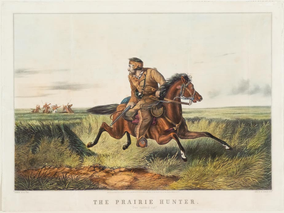 Man on horse in middle of prairie