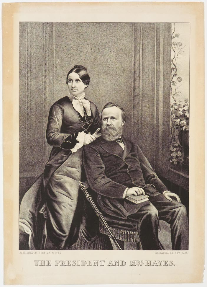 Man on right seated with book on proper right leg and proper right hand on book
