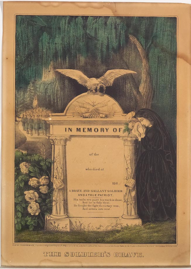 "Woman in black standing to right of large grave stone ""In Memory Of"" (at top)"