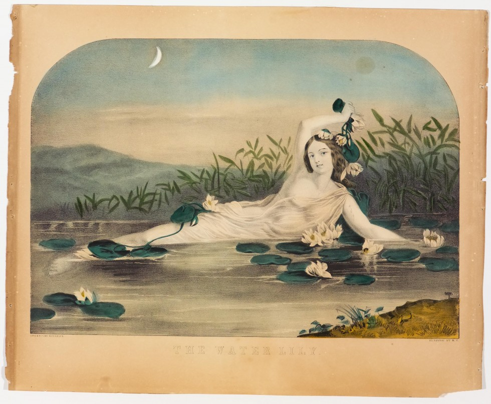 Woman reclining in water amidst lily pads
