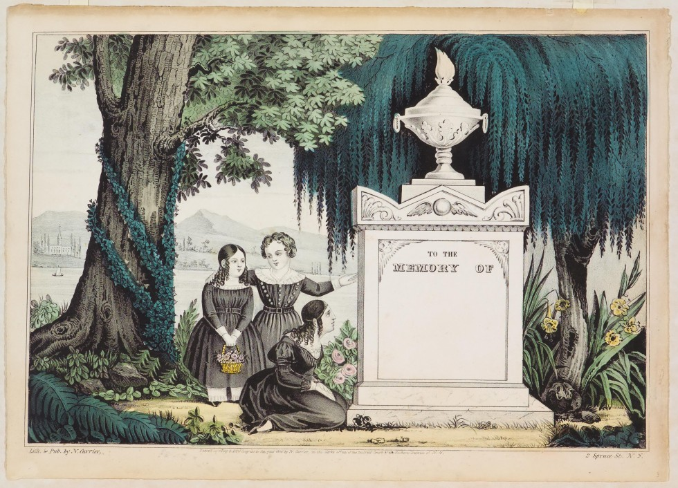 Three females (two standing one on ground kneeling to left of monument yet to be inscribed