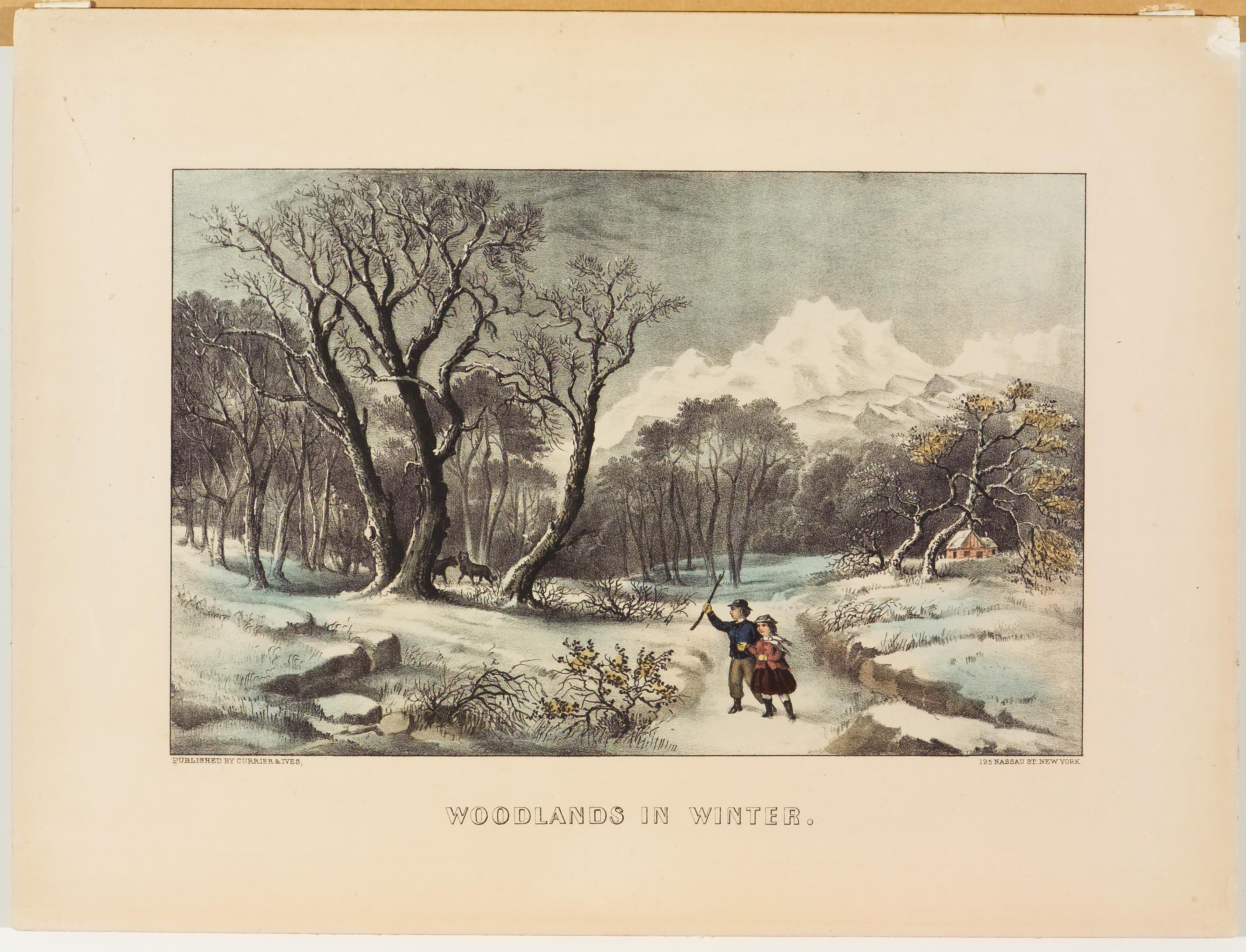 Woodland scene - couple walking down path toward center left