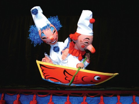 Clown puppets in a boat
