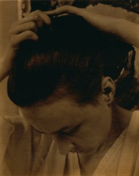 Photo of woman fixing her hair