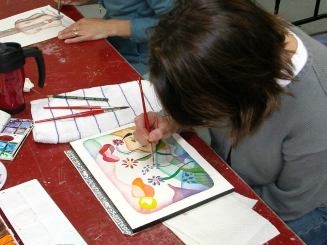 student painting with watercolor