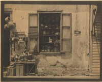 Sepia print photo of an old shop window.