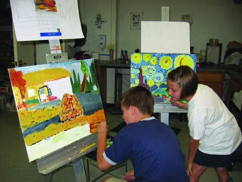 teens painting on canvas
