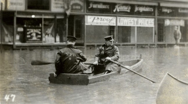 Police patrolling South Main Street during the flood of .36.