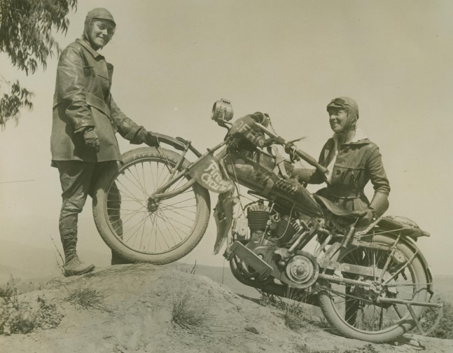 Van Buren Sisters posing on a hilltop with their Indian Motorcycle