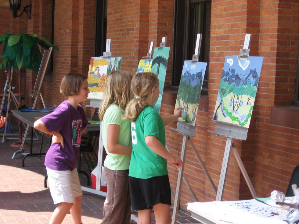 Three young people painting