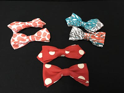 Six Seussian Bow Ties In A Variety Of Colors Including Red And White Polka Dots