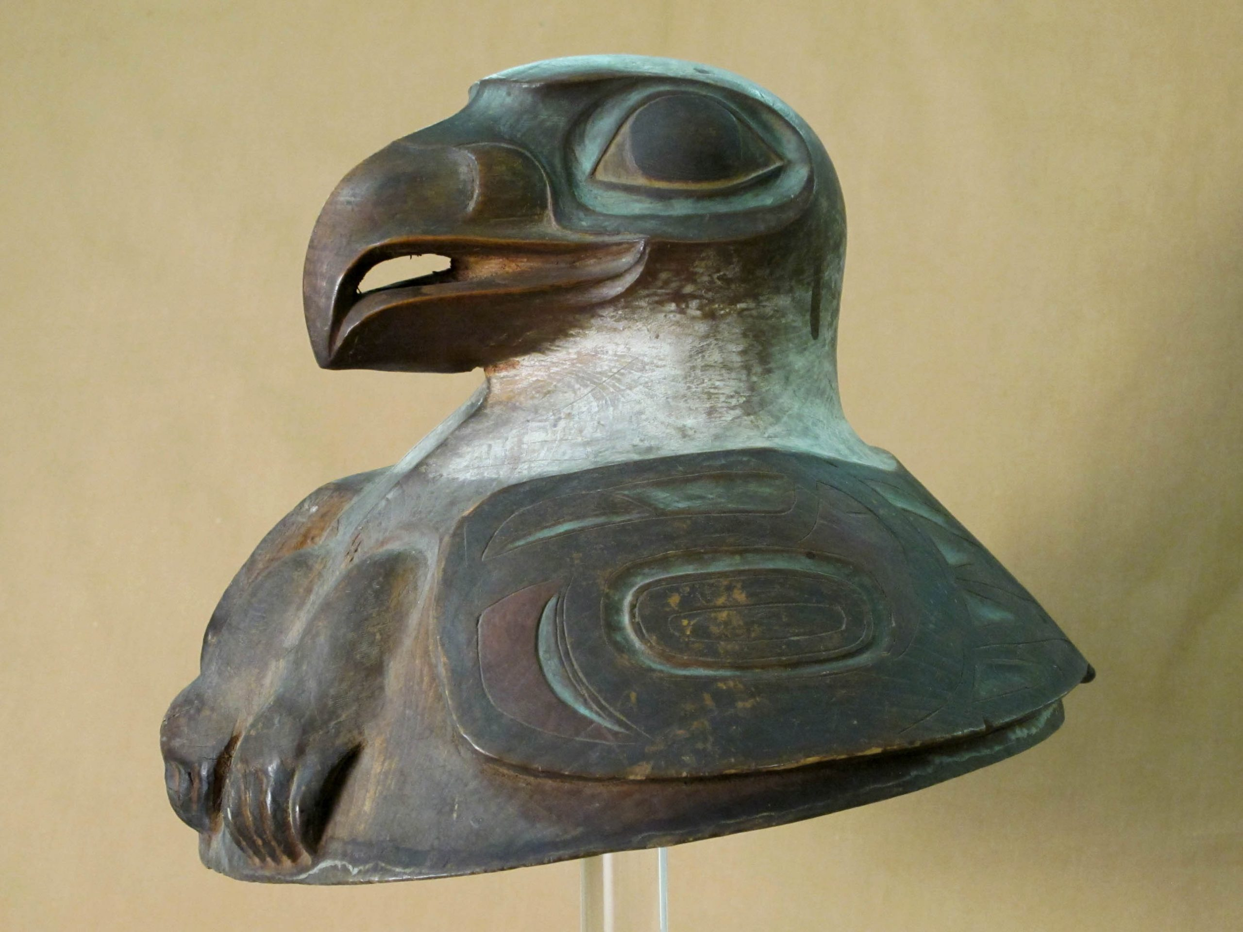 A Tlingit war helmet that includes the carved head of a beaked animal.