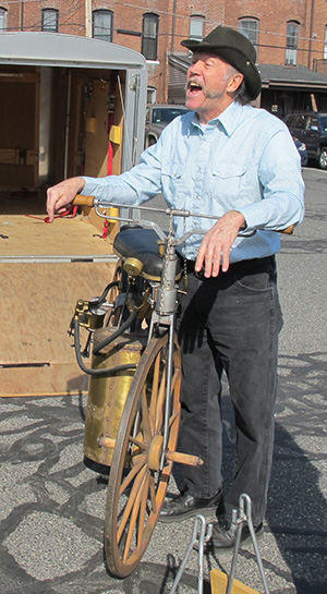 Bill Eggers Stands Next To Replica Of Steam Powered Velocipede