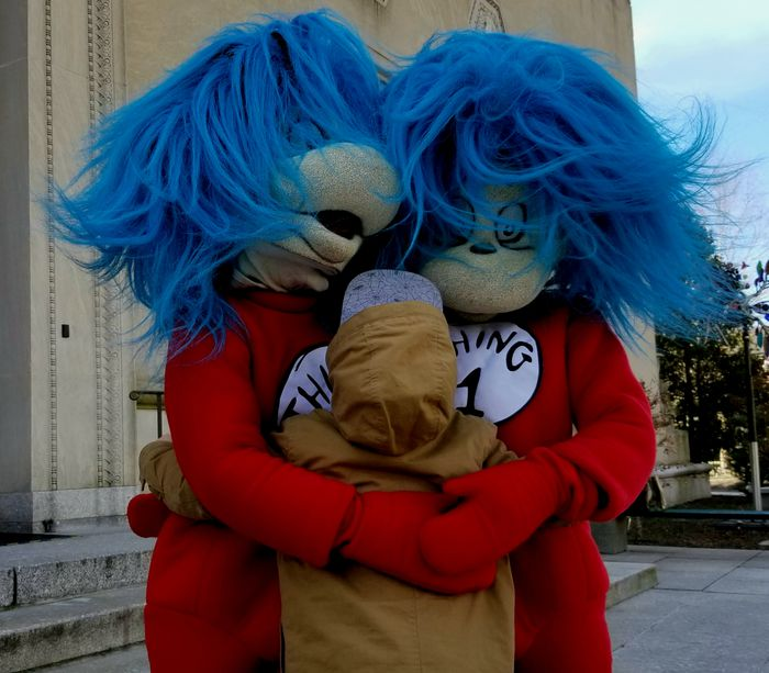 Child Hugs Costume Characters Thing One And Two To Celebrate Dr. Seuss Birthday