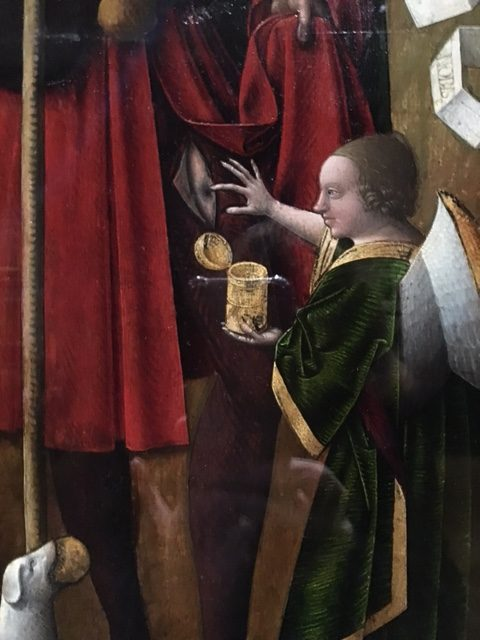 A close up of a painting that shows an small angel with white wings tending a person's plague sore with a heavenly salve