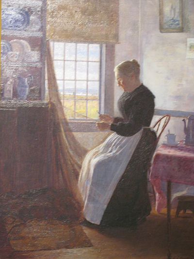 Painting Of Older Woman Mending A Fishing Net In The Bright Light Of A Window By The Sea