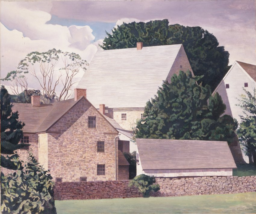 Scene Of Brick And Wood Homes Crowded With Rock Wall And Trees