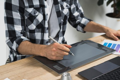 Man using tablet and stylus