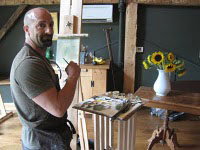 Man painting at an easel