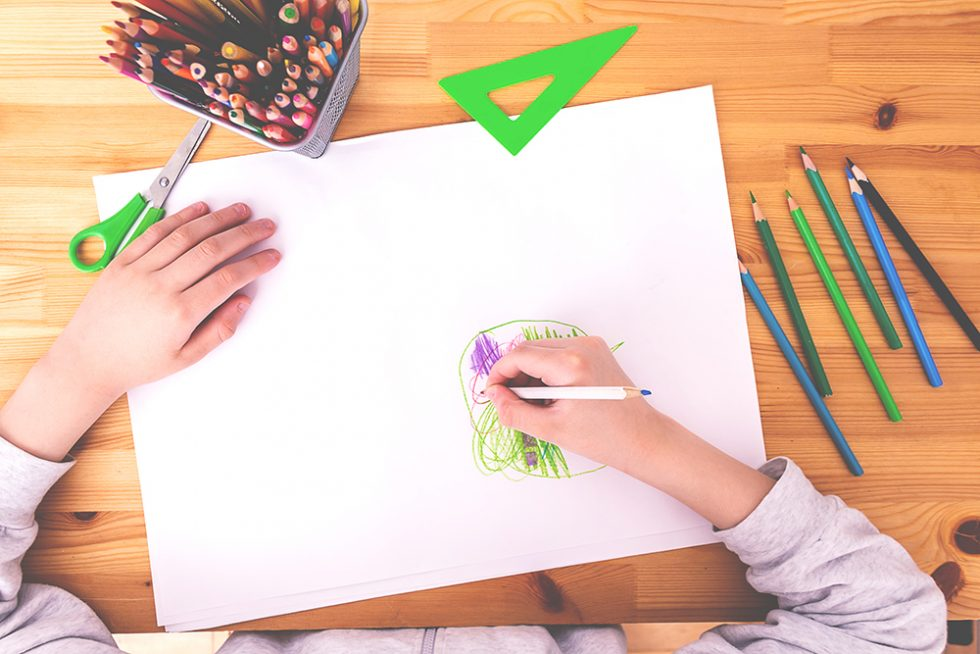 Child draws with crayons