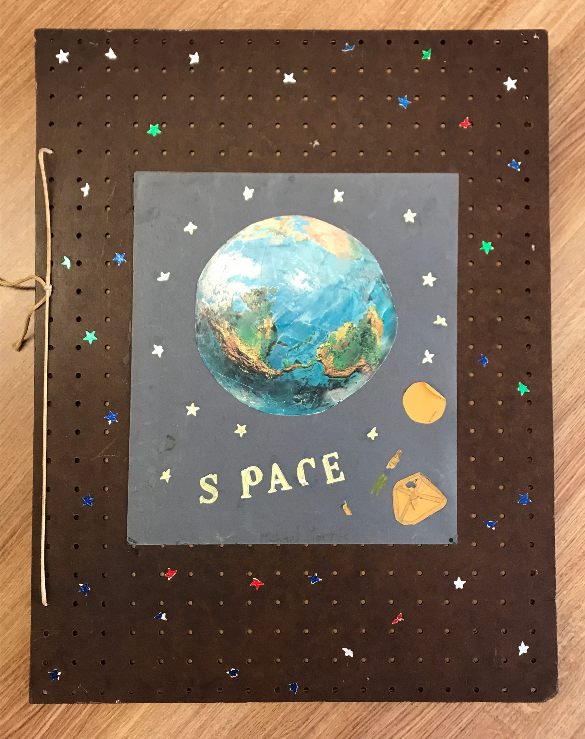 Scrap Book That Shows Earth From Space Surrounded By Stars